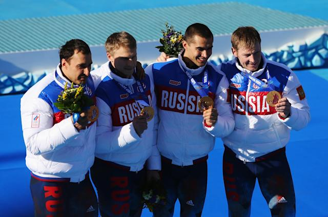 SOCHI, RUSSIA - FEBRUARY 23: Gold medalists Russia team 1 celebrate on the podium during the medal ceremony for the Four-Man Bobsleigh on Day 16 of the Sochi 2014 Winter Olympics at Sliding Center Sanki on February 23, 2014 in Sochi, Russia. (Photo by Alex Livesey/Getty Images)