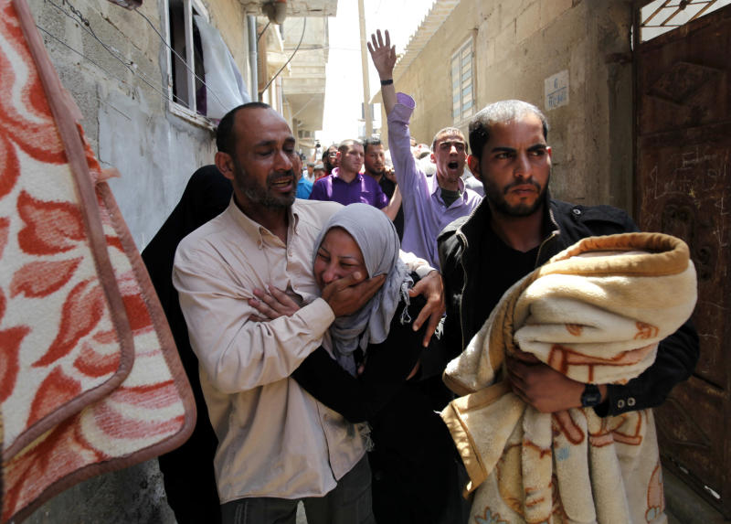 Palestinian relatives of Haitham Mishal, 29, react during his funeral in the Shati Refugee Camp in Gaza City, Tuesday, April 30, 2013. An Israeli aircraft attacked a motorcyclist in Gaza on Tuesday, killing the rider and wounding two other people in the first deadly airstrike in the Palestinian territory since a truce was reached with Palestinian militants last November. The Israeli military said the airstrike killed Haitham Mishal, whom it identified as a militant involved in the April 17 rocket attack on the southern Israeli resort town of Eilat. (AP Photo/Hatem Moussa)