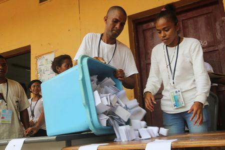 An election official empties a ballot box during the counting process of the presidential elections in Dili, East Timor  March 20, 2017. REUTERS/Lirio da Fonseca