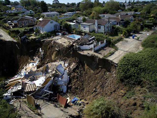 The rest of the house in Kent collapsed into a ravine after a further landslide on Tuesday morning. (SWNS)