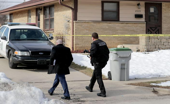 Investigators go to a house on Thursday, February 27, 2020, which is believed to be that of Molson Coors gunner on 8200 block on West Potomac Avenue in Milwaukee.