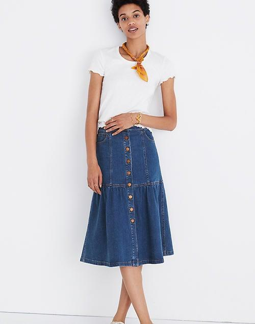 "<p>Mix and match this <a href=""https://www.popsugar.com/buy/Madewell-Denim-Bayview-Tiered-Midi-Skirt-582010?p_name=Madewell%20Denim%20Bayview%20Tiered%20Midi%20Skirt&retailer=madewell.com&pid=582010&price=90&evar1=fab%3Aus&evar9=35329485&evar98=https%3A%2F%2Fwww.popsugar.com%2Ffashion%2Fphoto-gallery%2F35329485%2Fimage%2F47550216%2FMadewell-Denim-Bayview-Tiered-Midi-Skirt&list1=shopping%2Cdenim%2Csummer%20fashion%2Cfashion%20shopping&prop13=mobile&pdata=1"" class=""link rapid-noclick-resp"" rel=""nofollow noopener"" target=""_blank"" data-ylk=""slk:Madewell Denim Bayview Tiered Midi Skirt"">Madewell Denim Bayview Tiered Midi Skirt</a> ($90, originally $98) with your favorite tees.</p>"