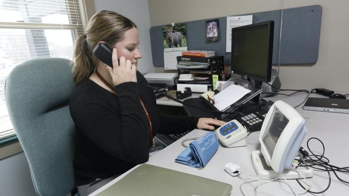 "<span class=""caption"">Amy Blais, a telehealth nurse at HomeHealth Visiting Nurses in Saco, Maine. </span> <span class=""attribution""><a class=""link rapid-noclick-resp"" href=""https://www.gettyimages.com/detail/news-photo/amy-blais-is-a-telehealth-nurse-at-homehealth-visiting-news-photo/451571238?adppopup=true"" rel=""nofollow noopener"" target=""_blank"" data-ylk=""slk:Derek Davis/Portland Press Herald via Getty Images"">Derek Davis/Portland Press Herald via Getty Images</a></span>"