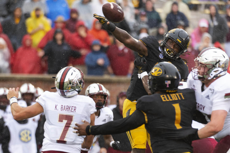 FILE - In this Oct. 5, 2019, file photo, Missouri linebacker Nick Bolton, top right, blocks the pass of Troy quarterback Kaleb Barker, bottom, left, during the first half of an NCAA college football game, in Columbia, Mo. Bolton was selected to The Associated Press All-Southeastern Conference football team, Monday, Dec. 9, 2019. (AP Photo/L.G. Patterson, File)
