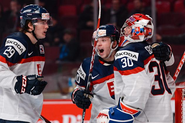 Martin Reway (centre) celebrates a Slovakia win with wing Matej Paulovic (left) and goalie Denis Godla (Photo by Minas Panagiotakis/Getty Images)