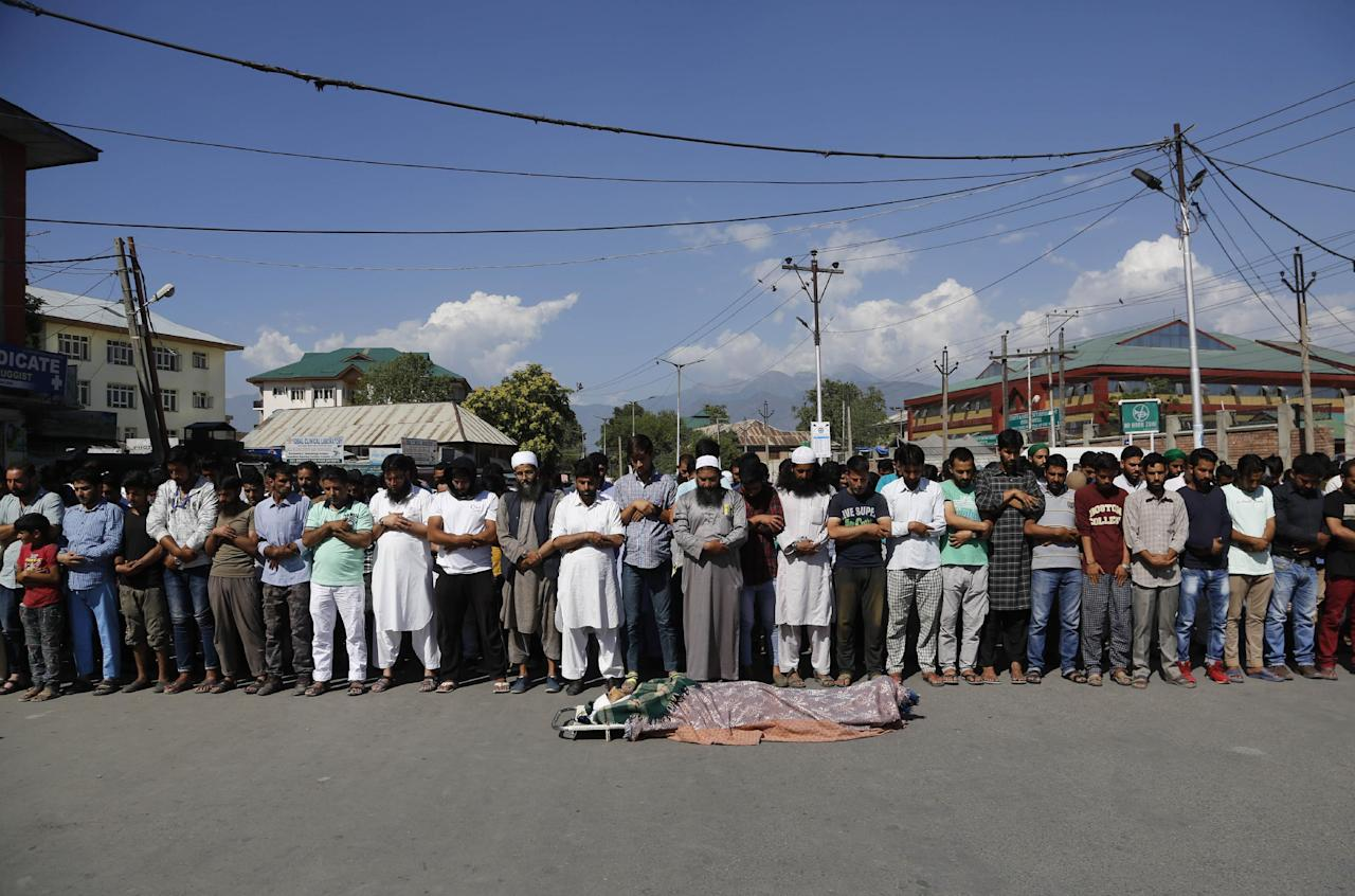 Kashmiri Muslims offer funeral prayers for a Kashmiri civilian Ghulam Mohammad Mir, who succumbed to injury allegedly attained during a protest last week, outside a hospital in Srinagar, India, Wednesday, July 20, 2016. The largest street protests in recent years in the disputed region, that left dozens of people dead and hundreds injured erupted more than a week ago after Indian troops killed a popular young rebel leader. (AP Photo/Mukhtar Khan)