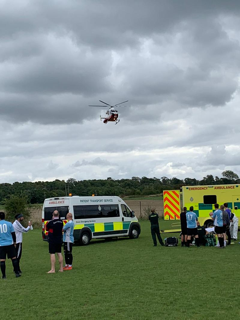 A helicopter arrives at the football pitch after a Sunday League footballer suffered a cardiac arrest