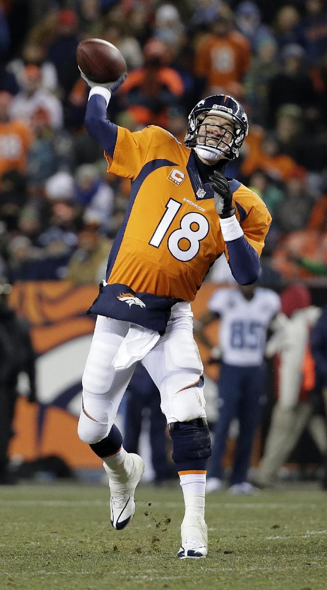 Denver Broncos quarterback Peyton Manning throws against the Tennessee Titans during the second half of an NFL football game on Sunday, Dec. 8, 2013, in Denver. (AP Photo/Jack Dempsey)