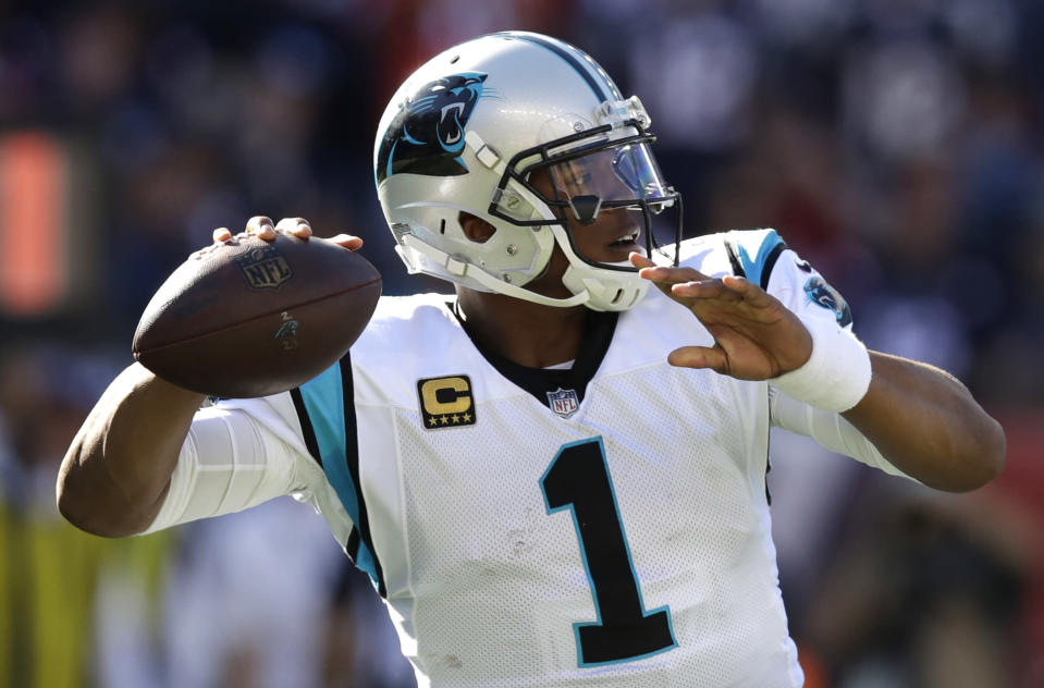 Carolina Panthers QB Cam Newton celebrates his rushing touchdown against the New England Patriots during the second half on Sunday. (AP)