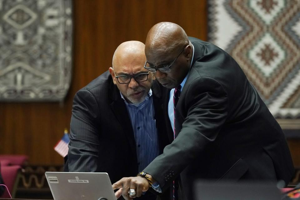 Rep. Diego Espinoza, D-Tolleson, left, looks at a computer with Rep. Walter Blackman, R-Snow Flake, during a vote on the Arizona budget Thursday, June 24, 2021, in Phoenix. (AP Photo/Ross D. Franklin)