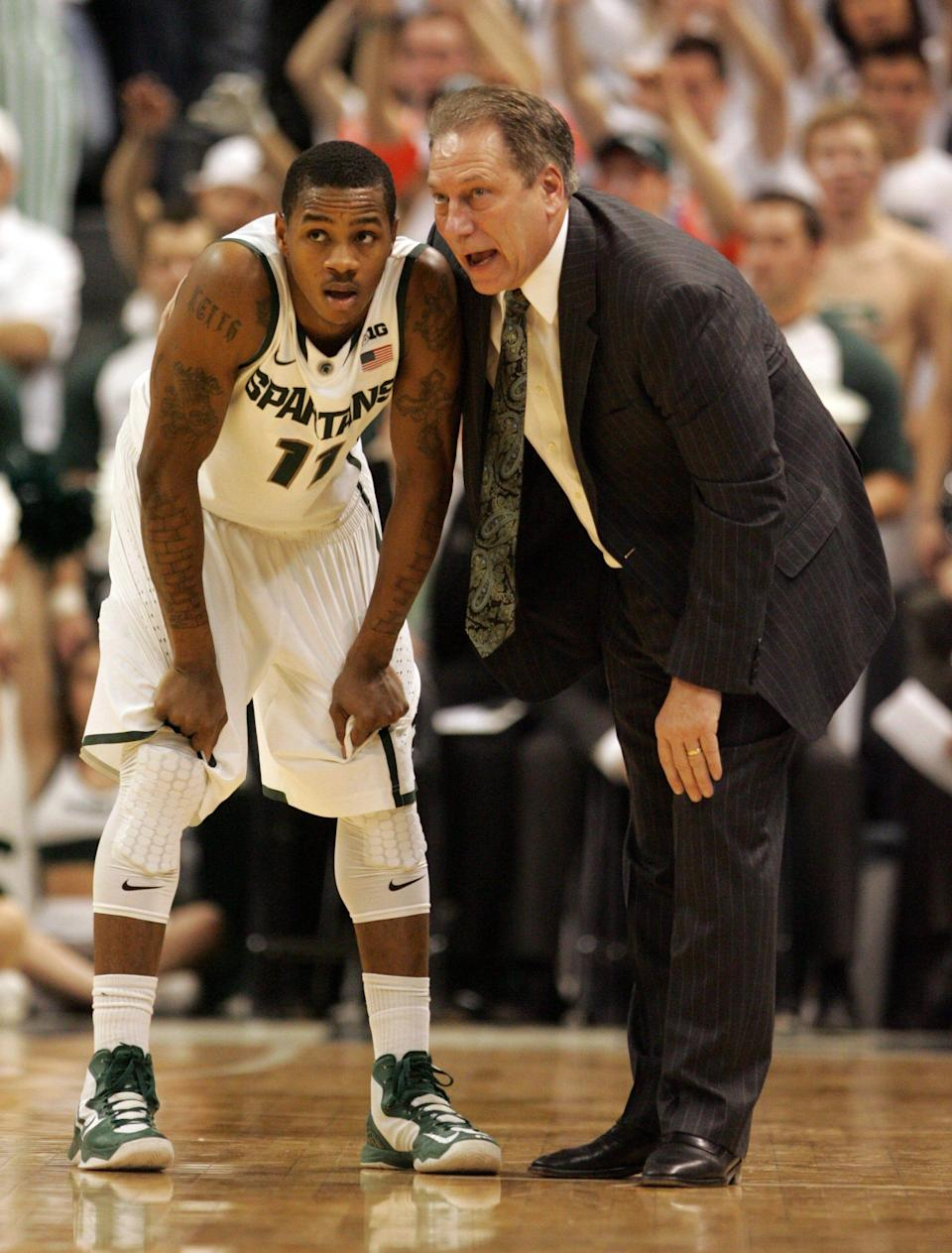 Michigan State coach Tom Izzo talks with guard Keith Appling during a game against Michigan, Feb.12, 2013 at the Breslin Center in East Lansing .