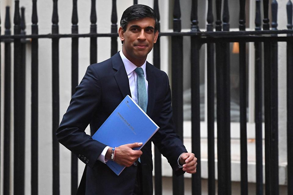 <p>Britain's Chancellor of the Exchequer Rishi Sunak leaves 11 Downing Street ahead of his spending review speech in the Commons</p>AFP via Getty Images