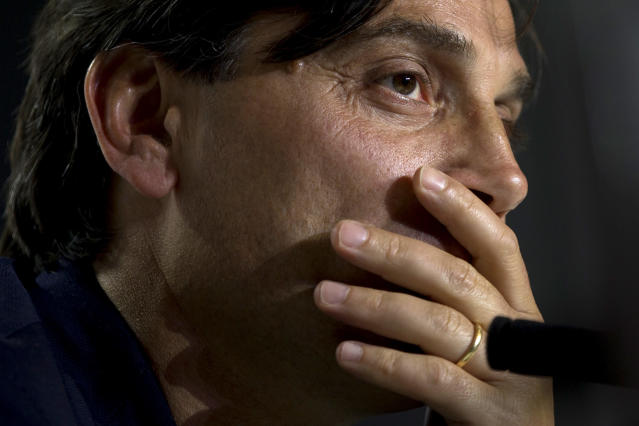 Sevilla coach Vincenzo Montella listens to a question during a press conference at the Wanda Metropolitano stadium in Madrid, Spain, Friday, April 20, 2018. Sevilla will play Barcelona Saturday in the Copa del Rey final soccer match in Madrid. (AP Photo/Paul White)