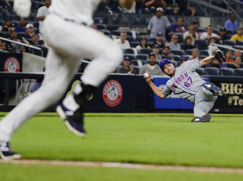 New York Mets starting pitcher Seth Lugo (67) attempts to throw out New York Yankees' Greg Bird during the eighth inning of a baseball game Monday, Aug. 13, 2018, in New York. Bird was safe at first base on the play. (AP Photo/Frank Franklin II)