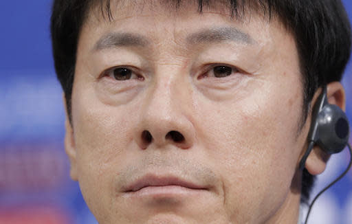 South Korea's head coach Shin Tae-yong listens to reporter's question during the press conference before South Korea's official training on the eve of the group F match between Sweden and South Korea at the 2018 soccer World Cup in the Nizhny Novgorod stadium in Nizhny Novgorod, Russia, Sunday, June 17, 2018. (AP Photo/Lee Jin-man)