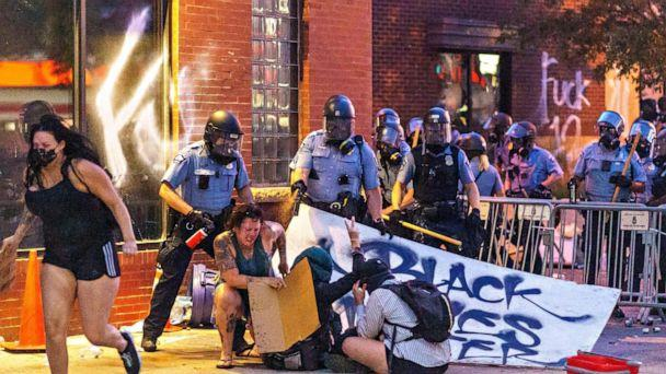 PHOTO: Police use pepper spray on protesters during a demonstration outside the Third Police Precinct over the death of George Floyd, May 27, 2020 in Minneapolis. (Kerem Yucel/AFP via Getty Images)