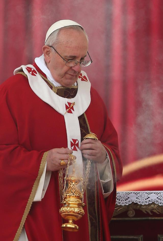 VATICAN CITY, VATICAN - MARCH 24: Pope Francis holds a thurible as he attends Palm Sunday Mass in St. Peter's Square on March 24, 2013 in Vatican City, Vatican. Pope Francis lead his first mass of Holy Week as pontiff by celebrating Palm Sunday in front of thousands of faithful and clergy. The pope's first holy week will also incorporate him washing the feet of prisoners in a youth detention centre in Rome next Thursday March 28. (Photo by Christopher Furlong/Getty Images)