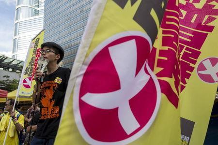Student leader Joshua Wong chants slogans during a march to demand lawmakers reject a Beijing-vetted electoral reform package for the city's first direct chief executive election in Hong Kong, China June 14, 2015. REUTERS/Tyrone Siu -