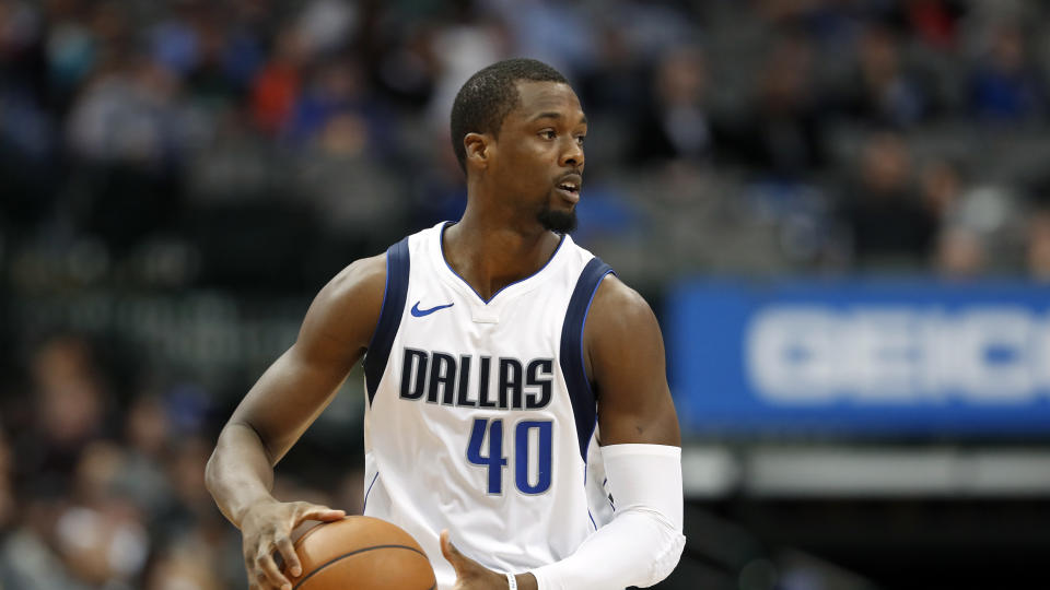 Dallas Mavericks' Harrison Barnes (40) handles the ball during an NBA basketball game against the Washington Wizards on Monday, Jan. 22, 2018, in Dallas. (AP Photo/Tony Gutierrez)