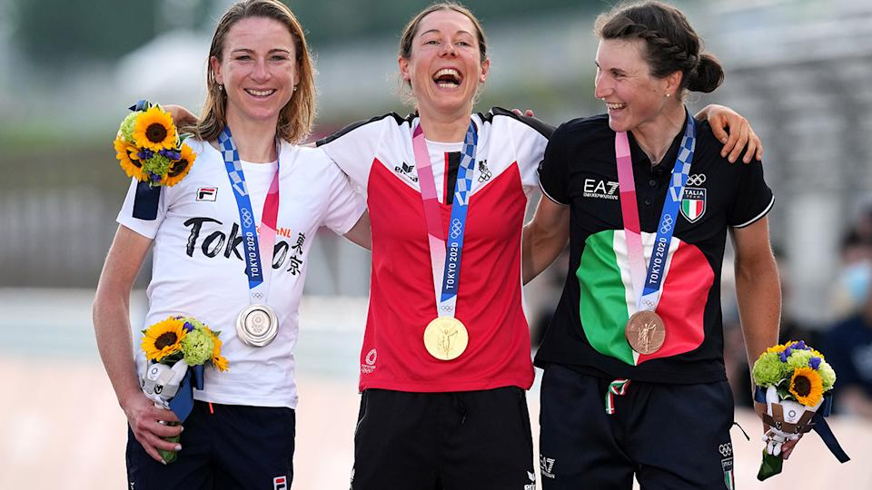 Austria's Anna Kiesenhofer (Gold), Netherlands' Annemiek van Vleuten (Silver) and Italy's Elisa Longo Borghini (Bronze) during the medal ceremony after the Women's Road Race at the Tokyo Olympics. (Photo by Martin Rickett/PA Images via Getty Images)