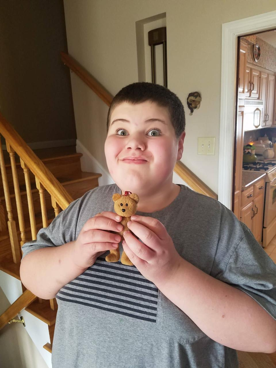 Ryan Paul, a 12-year-old with autism, poses with his teddy bear, Freddy. (Photo: Bob Paul)