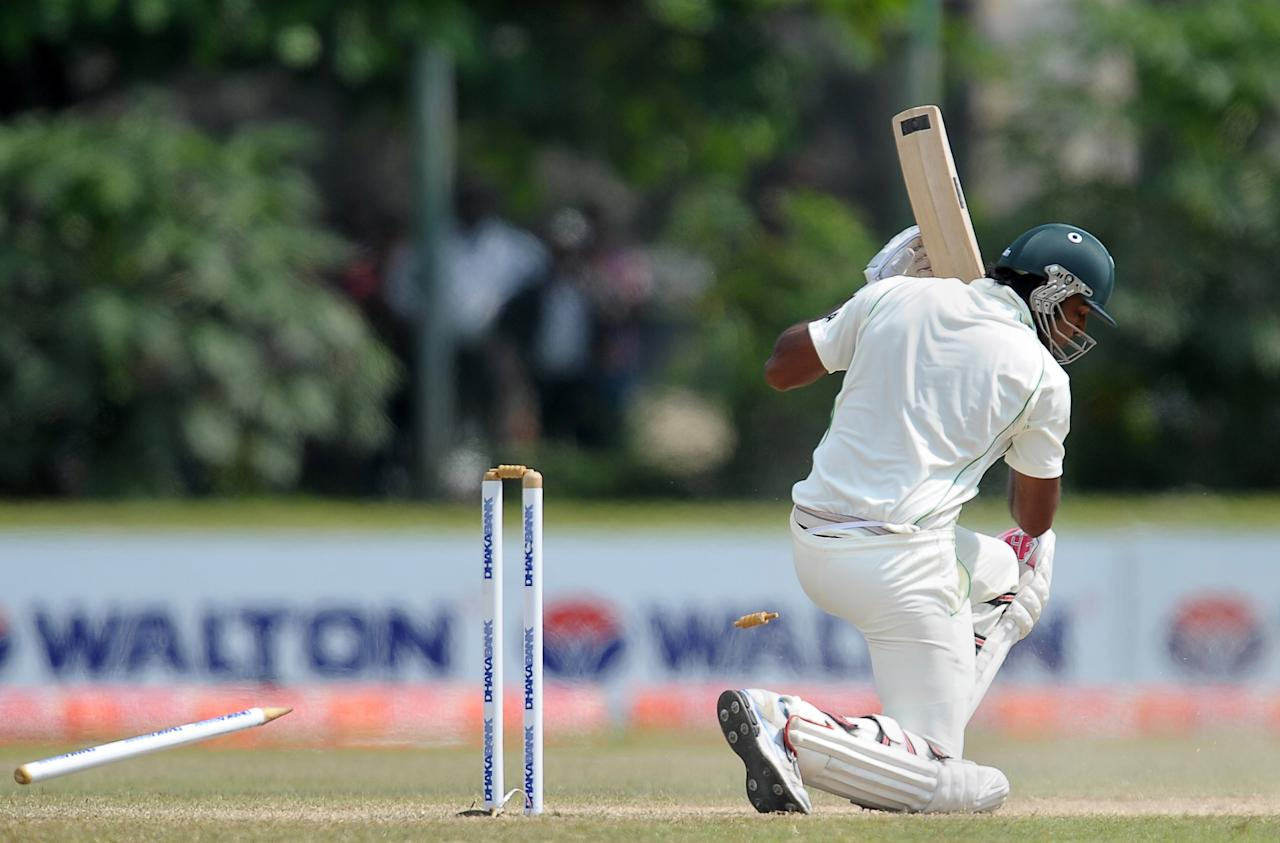 Bangladeshi cricketer Shahadat Hossain is bowled during the fourth day of the opening Test match between Sri Lanka and Bangladesh at the Galle International Cricket Stadium in Galle on March 11, 2013.  AFP PHOTO/ LAKRUWAN WANNIARACHCHI        (Photo credit should read LAKRUWAN WANNIARACHCHI/AFP/Getty Images)