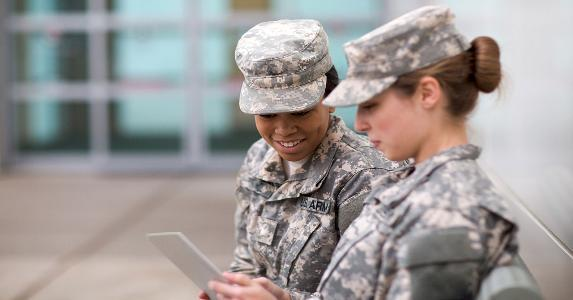 Two military women browsing tablet computer | Sean Murphy/Getty Images