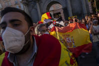 Spanish citizens gather during a protest against the arrival of migrants at the Spanish enclave of Ceuta, near the border of Morocco and Spain, on Tuesday, May 18, 2021. (AP Photo/Bernat Armangue)