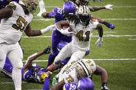 New Orleans Saints running back Alvin Kamara (41) carries for his fifth touchdown of the game, in the second half of an NFL football game against the Minnesota Vikings54 in New Orleans, Friday, Dec. 25, 2020. (AP Photo/Butch Dill)