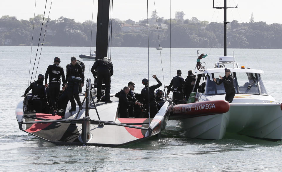 FILE - In this Sept. 18, 2019, file photo, New Zealand's America's Cup AC75 boat and crew leave their base at Auckland's Viaduct Harbour for a test sail on Waitemata Harbour, in Auckland, New Zealand. The futuristic present and storied past of the America's Cup will converge from Friday, Jan. 15, 2021 at Auckland, New Zealand when racing begins to find the latest winner of the famous sailing trophy first contested in 1851. (AP Photo/Mark Baker, File)