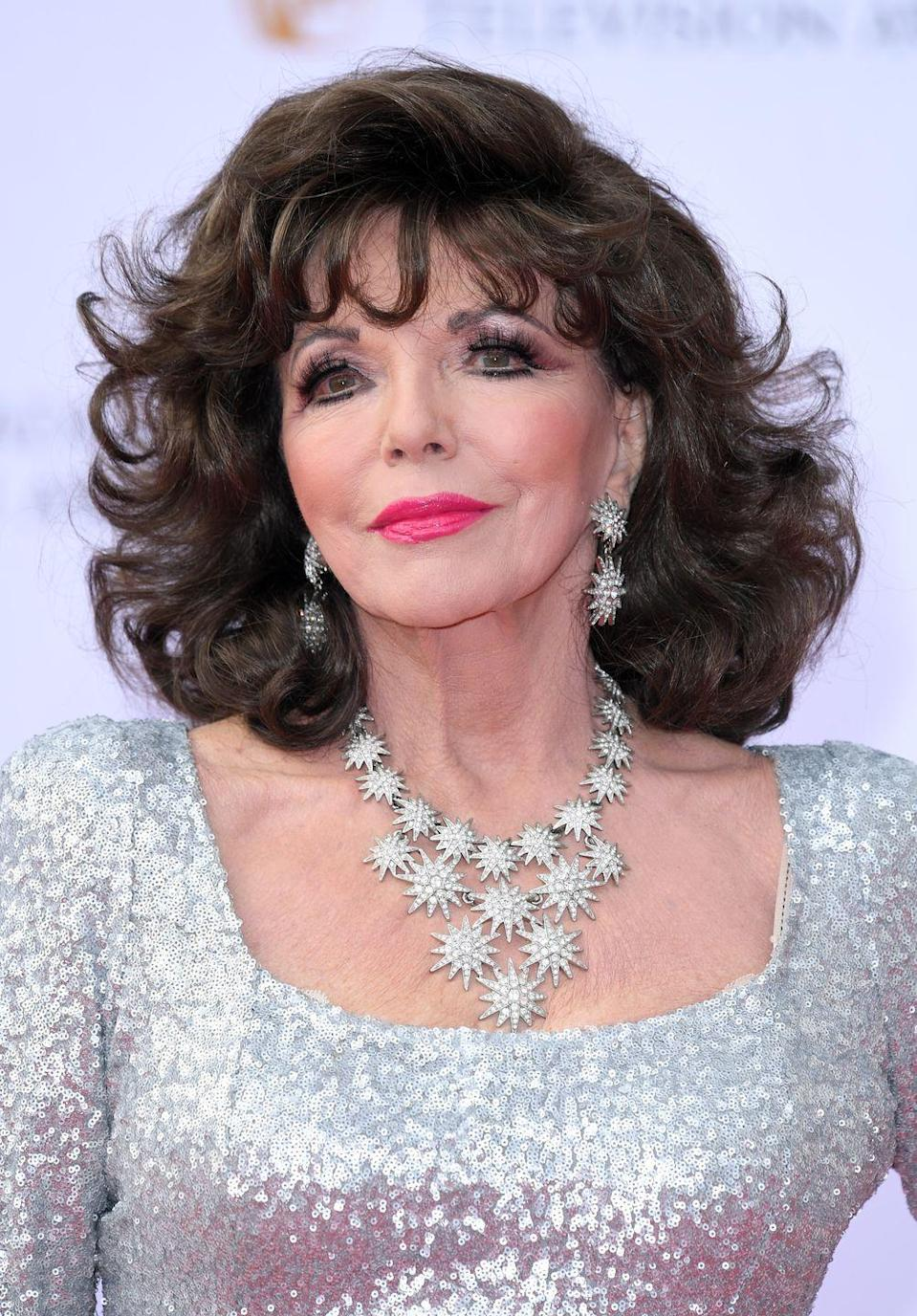 <p>Collins channelled intergalactic chic in a gleaming silver gown and a galaxy of white diamonds. </p>