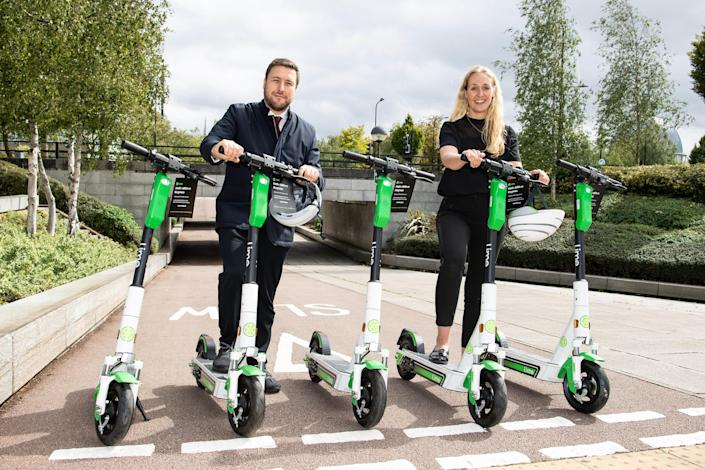 Cllr Pete Marland, leader of Milton Keynes Council and Florence Milner, general manager UK and Ireland Lime, as Lime launches the UK's first, full-scale e-scooter service in Milton Keynes. (PA)