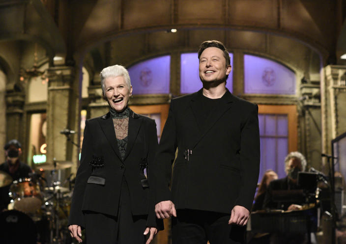 """This image released by NBC shows host Elon Musk with his mother Maye as he delivers his opening monologue on """"Saturday Night Live"""" in New York on May 8, 2021. (Will Heath/NBC via AP)"""