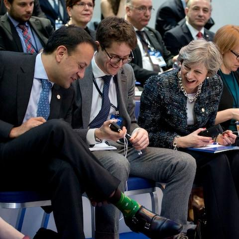 Irish Prime Minister Leo Varadkar, left, shows his decorative socks to British Prime Minister Theresa May, second right, during a round table meeting at an EU summit in Goteborg, Sweden on Friday, Nov. 17 - Credit: AP