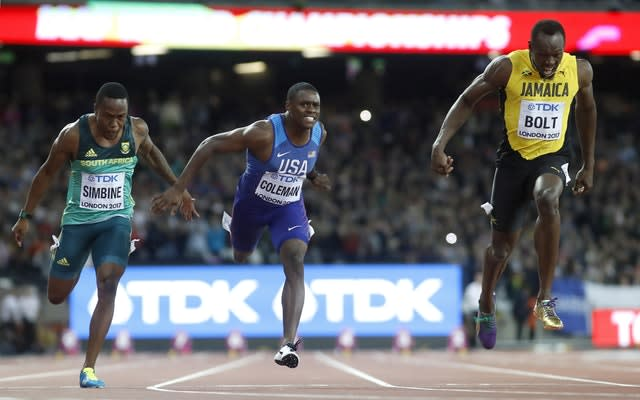 Christian Coleman, pictured centre, is free to compete in Doha (Martin Rickett/PA)