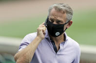 FILE - In this July 8, 2020, file photo, Chicago Cubs general manager Jed Hoyer talks on a mobile phone during the team's baseball practice at Wrigley Field in Chicago. Chicago Cubs manager David Ross and president of baseball operations Jed Hoyer have tested positive for COVID-19. (AP Photo/Nam Y. Huh, File)