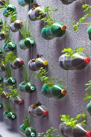 """<p>Use empty water or soda bottles to create a vertical garden like the one detailed <a href=""""http://dirt.asla.org/2013/08/13/diy-vertical-gardening/"""" rel=""""nofollow noopener"""" target=""""_blank"""" data-ylk=""""slk:here"""" class=""""link rapid-noclick-resp"""">here</a>. Perfect for urban settings — this garden can fit right on a balcony or the side of your house. Make it your own oasis of fresh herbs for cooking, plant your favorite flowers, or create a combination of both. (Photo: <a href=""""http://dirt.asla.org/2013/08/13/diy-vertical-gardening/"""" rel=""""nofollow noopener"""" target=""""_blank"""" data-ylk=""""slk:The Dirt"""" class=""""link rapid-noclick-resp"""">The Dirt</a>)</p>"""