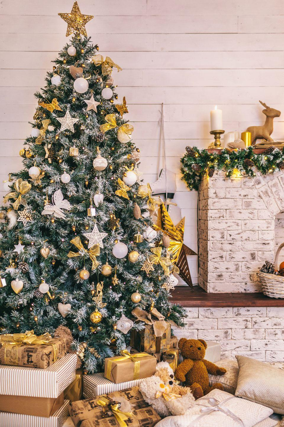 <p>Gold ornaments and bows make this arrangement a winner with or without tinsel. </p>