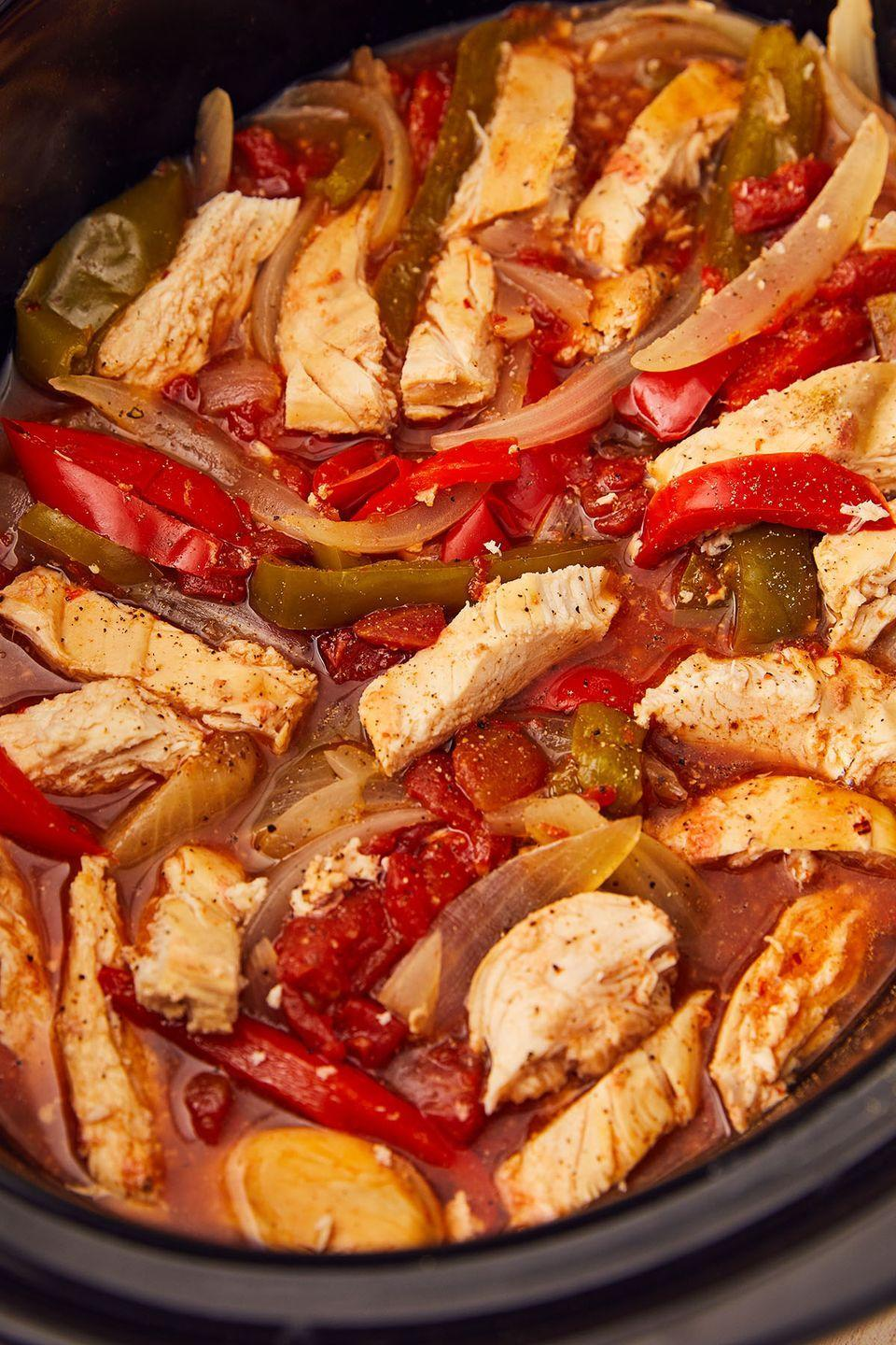 """<p><a href=""""https://www.delish.com/cooking/recipe-ideas/a25647730/keto-tortilla-recipe/"""" rel=""""nofollow noopener"""" target=""""_blank"""" data-ylk=""""slk:Use keto tortillas"""" class=""""link rapid-noclick-resp"""">Use keto tortillas</a> and feel good about loading up on the cheese and guac!</p><p>Get the recipe from <a href=""""https://www.delish.com/cooking/recipe-ideas/a22175263/crockpot-chicken-fajitas-recipe/"""" rel=""""nofollow noopener"""" target=""""_blank"""" data-ylk=""""slk:Delish"""" class=""""link rapid-noclick-resp"""">Delish</a>. </p>"""