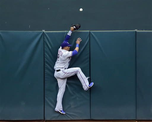 Texas Rangers center fielder Leonys Martin cannot catch a home run ball by Oakland Athletics' Yoenis Cespedes during the third inning of a baseball game on Monday, May 13, 2013 in Oakland. Calif. (AP Photo/Marcio Jose Sanchez)