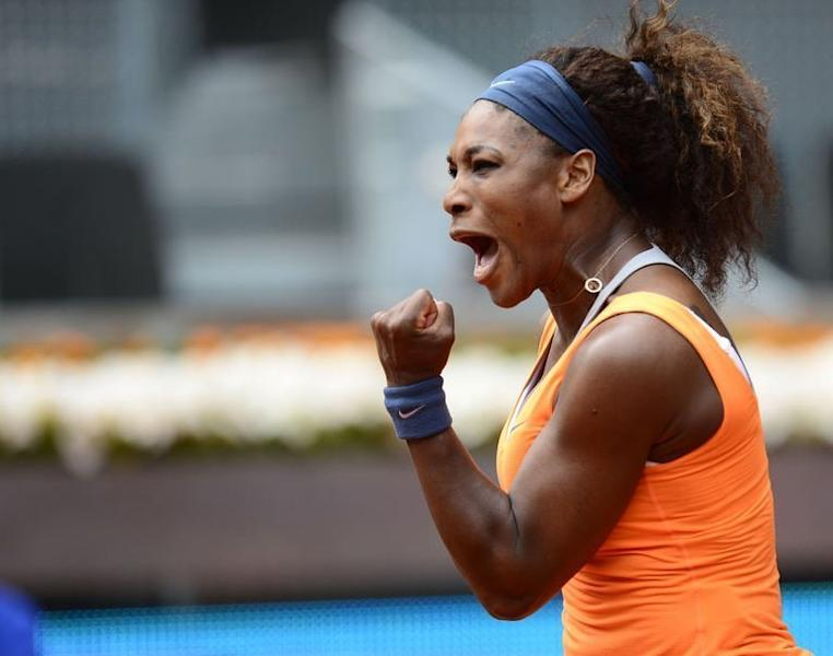 US player Serena Williams celebrates after beating Spain's Lourdes Dominguez Lino at the Madrid Masters on May 7, 2013. Williams won the match 6-2, 7-5