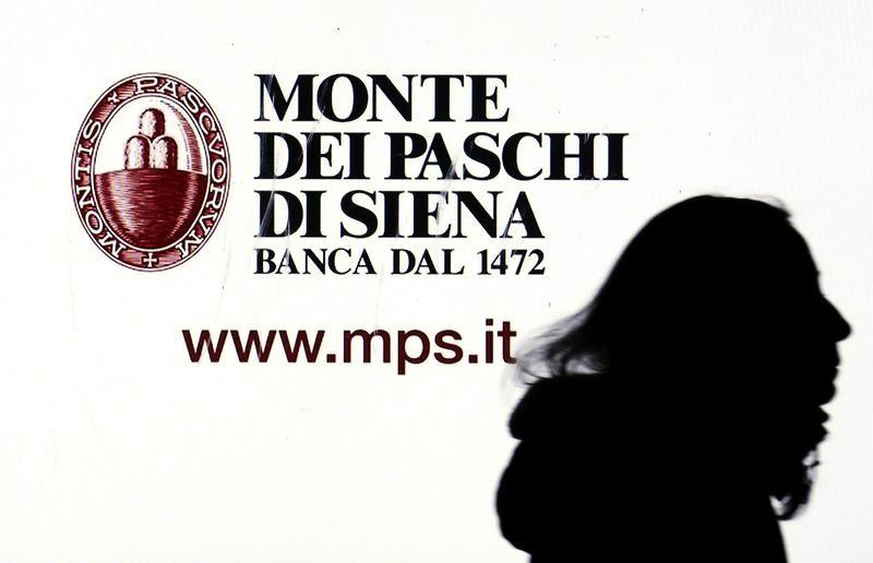 A Monte dei Paschi di Siena advertisement is seen on a screen in a bank window in downtown Milan