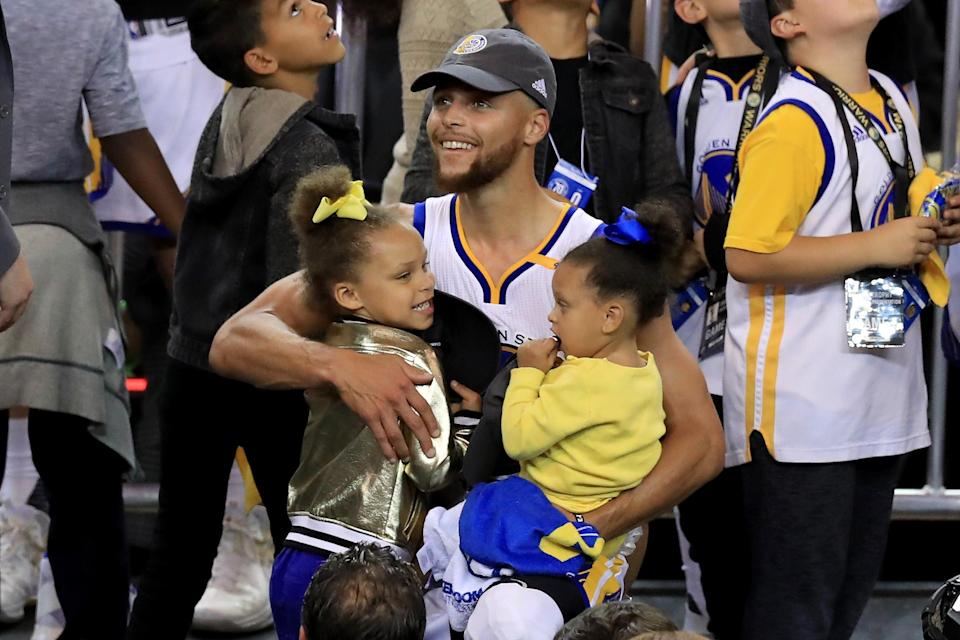 The Warriors' star point guard Steph Curry penned an op-ed this weekend about female empowerment, inspired by his two daughters Riley and Ryan, pictured above. (Getty Images)