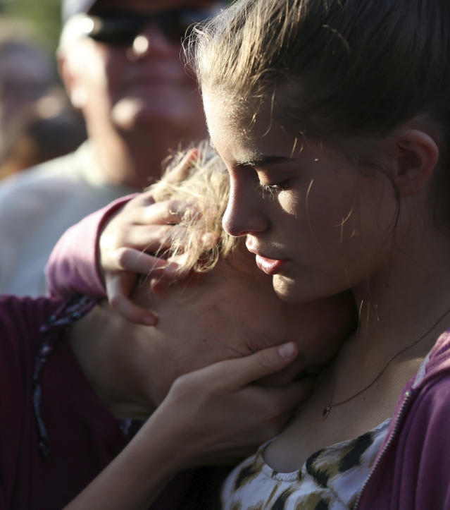 <p>Abigail Adams, right, comforts her friend Hannah Hershey, 13, during a vigil for the victims of the Santa Fe High School shooting Friday, May 18, 2018, in Santa Fe, Texas. Hershey said she knew one of the people who were killed at the high school earlier that day. (Photo: Godofredo A. Vasquez/Houston Chronicle via AP) </p>