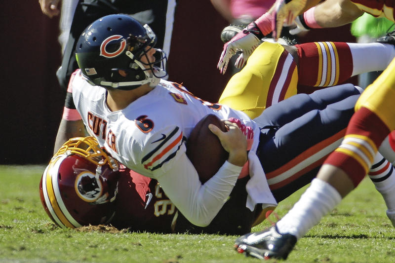 Chicago Bears quarterback Jay Cutler is sacked by Washington Redskins defensive end Chris Baker during the first half of a NFL football game in Landover, Md., Sunday, Oct. 20, 2013. Cutler was injured in the play. (AP Photo/Alex Brandon)