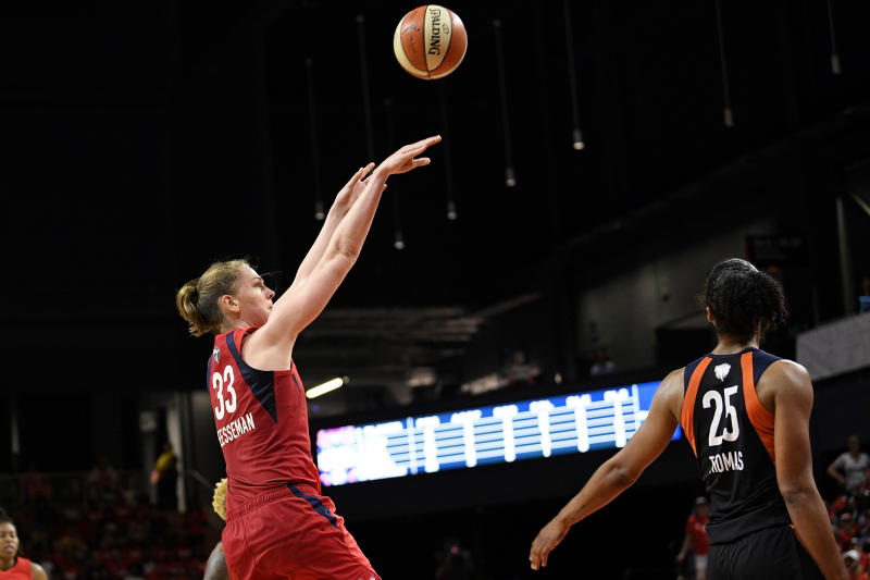 Washington Mystics center Emma Meesseman (33) shoots against Connecticut Sun forward Alyssa Thomas (25) in the second half of Game 2 of basketball's WNBA Finals, Tuesday, Oct. 1, 2019, in Washington. The Sun won 99-87. (AP Photo/Nick Wass)