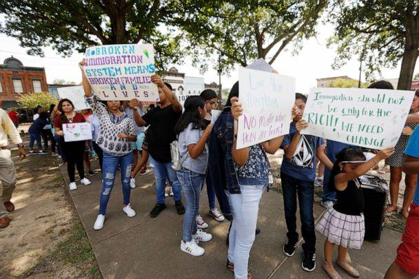 PHOTO: Children of mainly Latino immigrant parents hold signs in support of them and those who were picked up during an immigration raid at a food processing plant, during a protest march to the Madison County Courthouse in Canton, Miss., Aug. 11, 2019. (Rogelio V. Solis/AP)