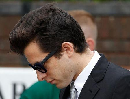 Music producer Mark Ronson leaves the funeral service for Amy Winehouse at a cemetery in north London July 26, 2011.    REUTERS/Stefan Wermuth