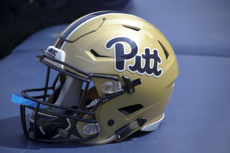 "A Pittsburgh football helmet with the ""Pitt"" script is on a training table during the annual Pittsburgh Spring NCAA football scrimmage, Saturday, April 15, 2017, in Pittsburgh. (AP Photo/Keith Srakocic)"
