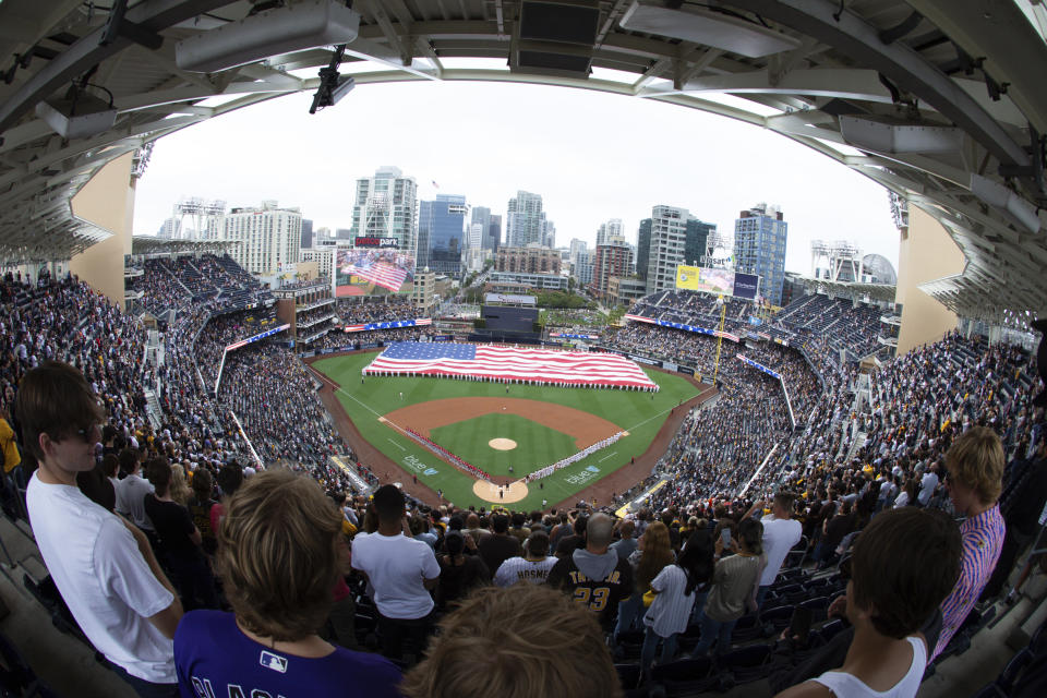A giant United States flag is displayed during the national anthem prior to a baseball game between the San Diego Padres and the Cincinnati Reds, Thursday, June 17, 2021, in San Diego. (AP Photo/Derrick Tuskan)